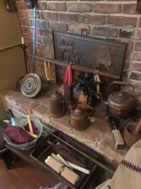 Antique copper pitchers, wood candleholder, brass bed warmer, antique knife box, wooden mortar and pestle, primitive iron candle holder