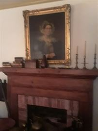 Oil portrait of prominent woman in gold leaf frame; more treenware carvings, candlesticks, box, books
