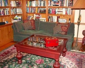 Sofa, Accent Pillows, Books, Floor Lamp and Rug
