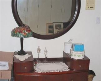 Cabinet with Tiffany Style Lamps and Large Round Mirror