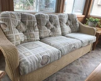 Wicker sofa with cushions