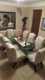 Solid beveled glass large dining table with eight chairs in excellent condition