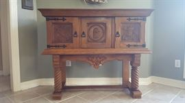 19Th. CENTURY ANTIQUE GORGEOUS RENAISSANCE CASTLE HALLWAY SPANISH OAK, ALL CARVED SIDEBOARD/SERVER/CREDENZA WITH THREE DOORS FROM SPAIN IN GOOD CONDITION WITH SOME WEAR EXPECTED WITH THE AGE AND LOTS OF MOVINGS…THIS FABULOUS PIECE HAS BEEN IN MY FAMILY FOR OVER THREE GENERATIONS.