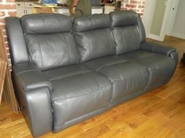 Gray leather couch w/recliners on both ends. 2 yrs old