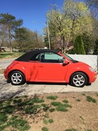 2004 VW Beetle convertible...very cute! Stick shift