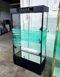 Really nice lighted showcase with glass shelves - each shelf has spotlights