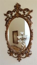 Another ornate oval mirror.