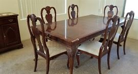 Beautiful Dining Table with 6 chairs. Can easily fit 8. Would be great with upholstered end chairs.