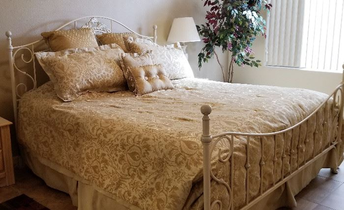 White metal bed. Great style making any small room look bigger and airy.