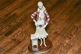 10. Figurine of an Elegant Woman