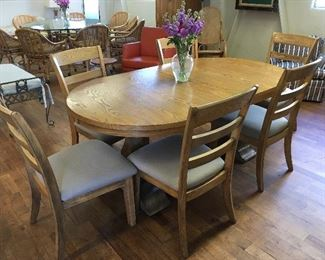 Modern dining table & 6 chairs. Low estimate $350