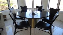 "Anello Table 60"" diameter Andes black granite top with bronze satin barrel base (designer George Mulhauser), 6 Chairs. Matching bar stools"