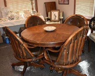 DINING TABLE W/1 LEAF & 4 ROLLING CHAIRS