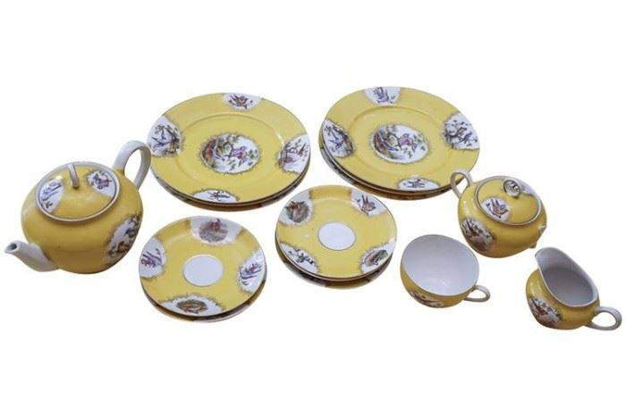 129. Partial Bohemian Tea Service in Yellow Handpainted Porcelain