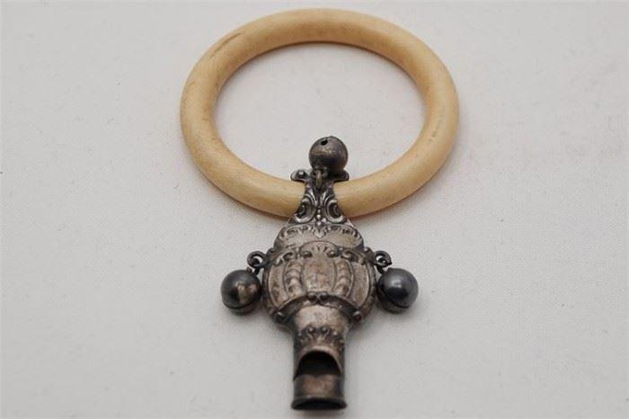 440. Bone Silver Rattle