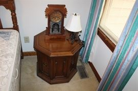 octagon table, clock and lamp
