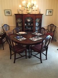 Beautiful Cherry table with shield back chairs. China cabinet is not for sale