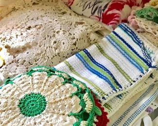 Lace doilies, crocheted hotpads