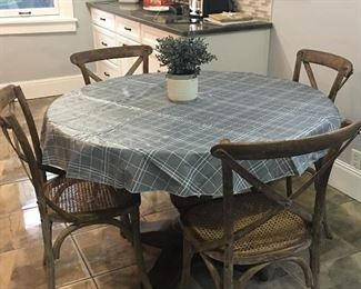 Brand new Restoration Hardware table and chairs.