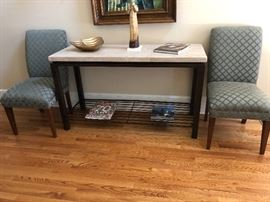 Decorator quality foyer table with matching custom upholstery side chairs.