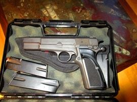 Browning 9 MM semi-automatic with large magazines. Fires 9 MM Luger ammunition. This weapon was made in Belgium and assembled in Portugal.  Whoever buys this weapon will have to pick it up at an FFL licensed gun store and pay for the standard Florida background check before being able to receive it.