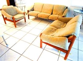 Danish mid century teak imports. Two sofas and a chair by Domino Mobler of Denmark with manufacturer's tags