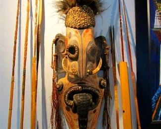 New  Guinea tribal mask with arrows and spears--pre 1960