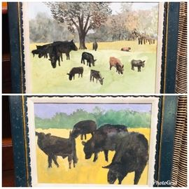 2 Primitive  framed watercolors of cows.