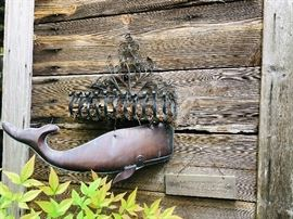 Copper whale, black planter and antique sign