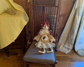 #4Antique low carved rocker with needle point seat  $65.00