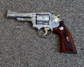 LOT # 21 - SMITH & WESSON MODEL 66-1 STAINLESS STEEL REVOLVER                                                                                                        AUCTION ESTIMATE $2,700.00 - $3,200.00                                                                                                              CALIBER .357 MAG., CUSTOM ENGRAVED BY THE LATE GARY RICHARDS OF GR ENGRAVING IN SAN ANTONIO, TEXAS.  VERY DEEP ENGRAVING WITH BLACK HIGHLIGHTS.  THIS IS AN EARLY MODEL 66 AND IT'S ABSOLUTELY GORGEOUS AND THE GUN IS NEW
