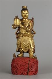 Chinese gilded wooden sculpture of an immortal, possibly 19th c., 12in(H)