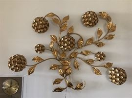 This fun floral wall decor piece lights up!