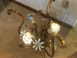 An end table with a metal floral sculpture that actually lights up!