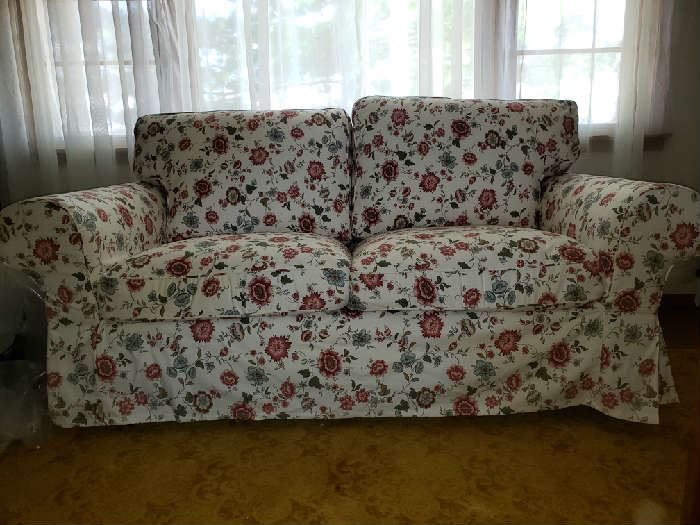 """""""Like new"""", Ikea loveseat. Covers are washable."""
