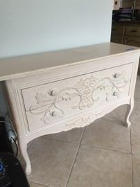 Awesome vintage dresser with raised wood floral design.
