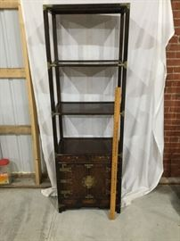 Shelving unit with storage underneath.