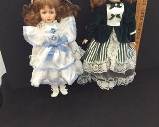 2 of several porcelain dolls on this sale.