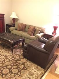 """Pair brown leather chairs by Vangard.  Also a footstool.  End tables are Baker. Sofa 6'4"""" End Tables 28"""""""