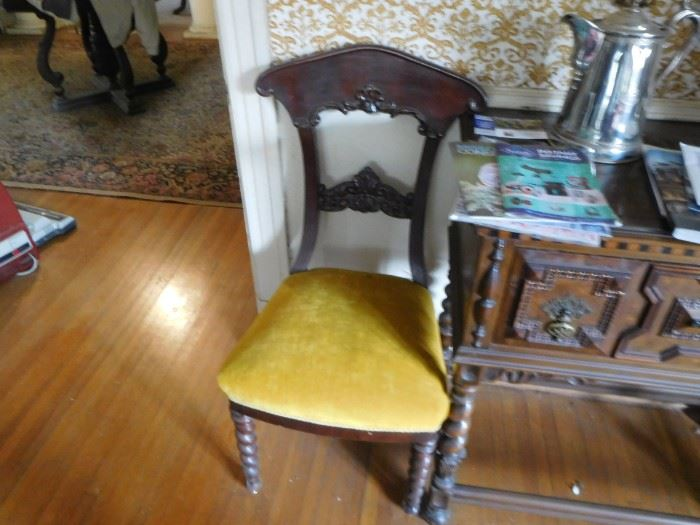 one  of  three  chairs  with  gold  fabric