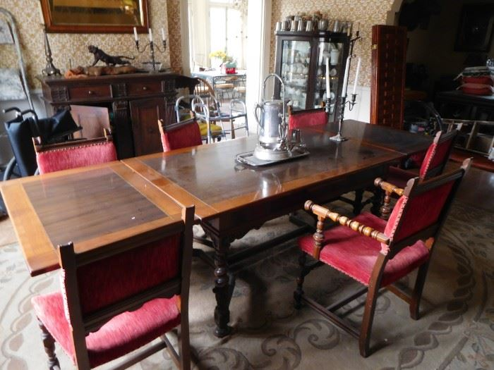 refractory dining  room  table  with  red  chairs