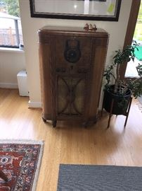 """Antique radio converted to a bar!  Top opens and the face of the radio opens like a door 25.5""""w x 41.5""""h x 15.5""""d  Asking $240   asking $60 for the plant"""