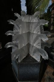 Lalique Water Fall.  Told by the client it is one of three in the world and they paid $300,000.00 for it.  There is damage to at least four corners.  Went to auction in 2016 with a minimum reserve of $120,000, and did not sell.  Resting on custom stand.