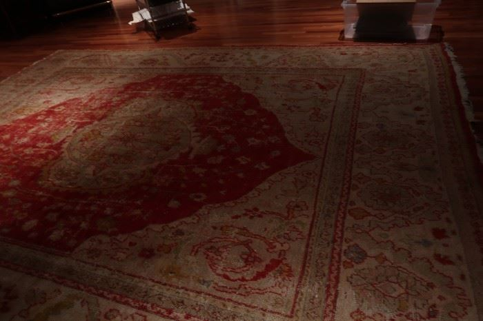 Several large area rugs
