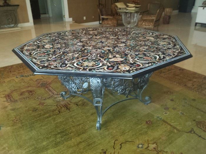 Inlaid table of multiple stones including Lapis Lazuli.