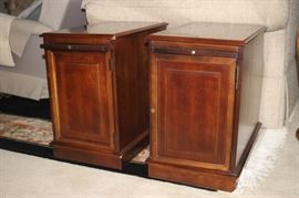 Two matching end tables with cocktail shelf.