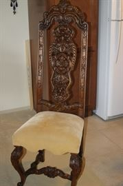 One single highly carved dining chair.
