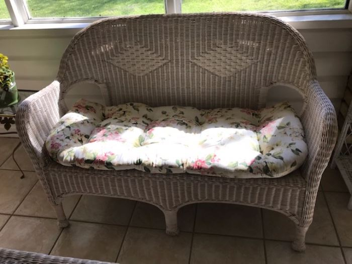 wicker sofa with cushion
