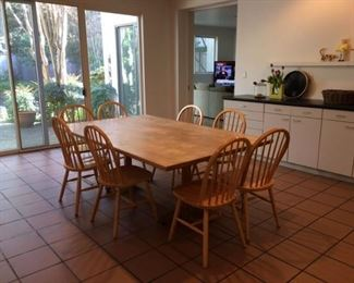 wood dining room table with 8 matching chairs