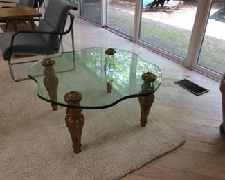 large glass top coffee table with gold legs